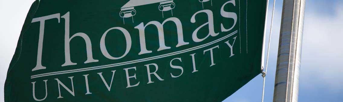 public relations Thomas University flag