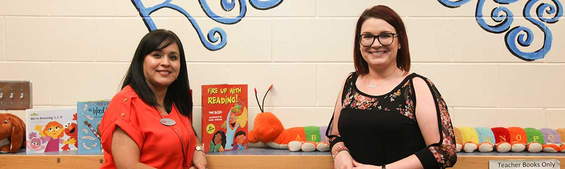 teachers in an elementary school library