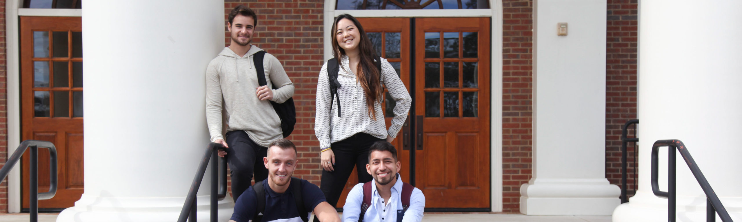 Business students in front of Smith-Bonvillian on Thomas University's campus